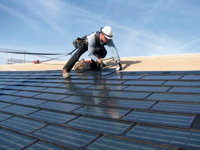 Roofer installing solar panels